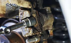 Как заменить колодки тормозные Мицубиси Лансер 9